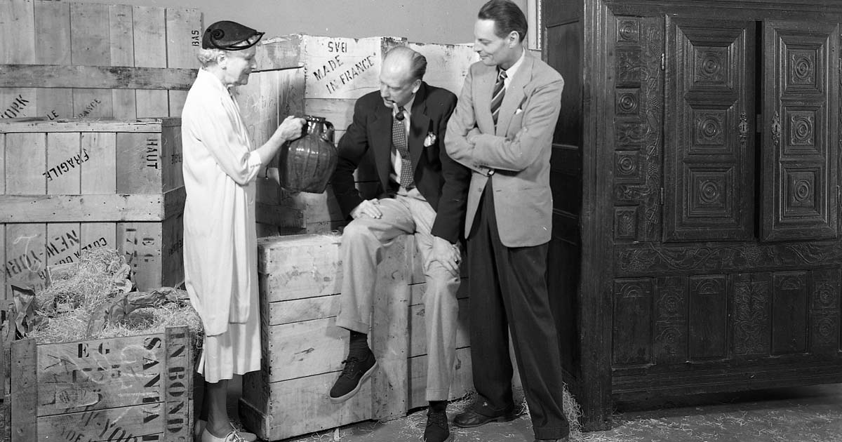 Florence Dibell Bartlett, Robert Bruce Inverarity, and Paul Coze examine a gift from France (image by Ernest Johanson, July 27, 1953)