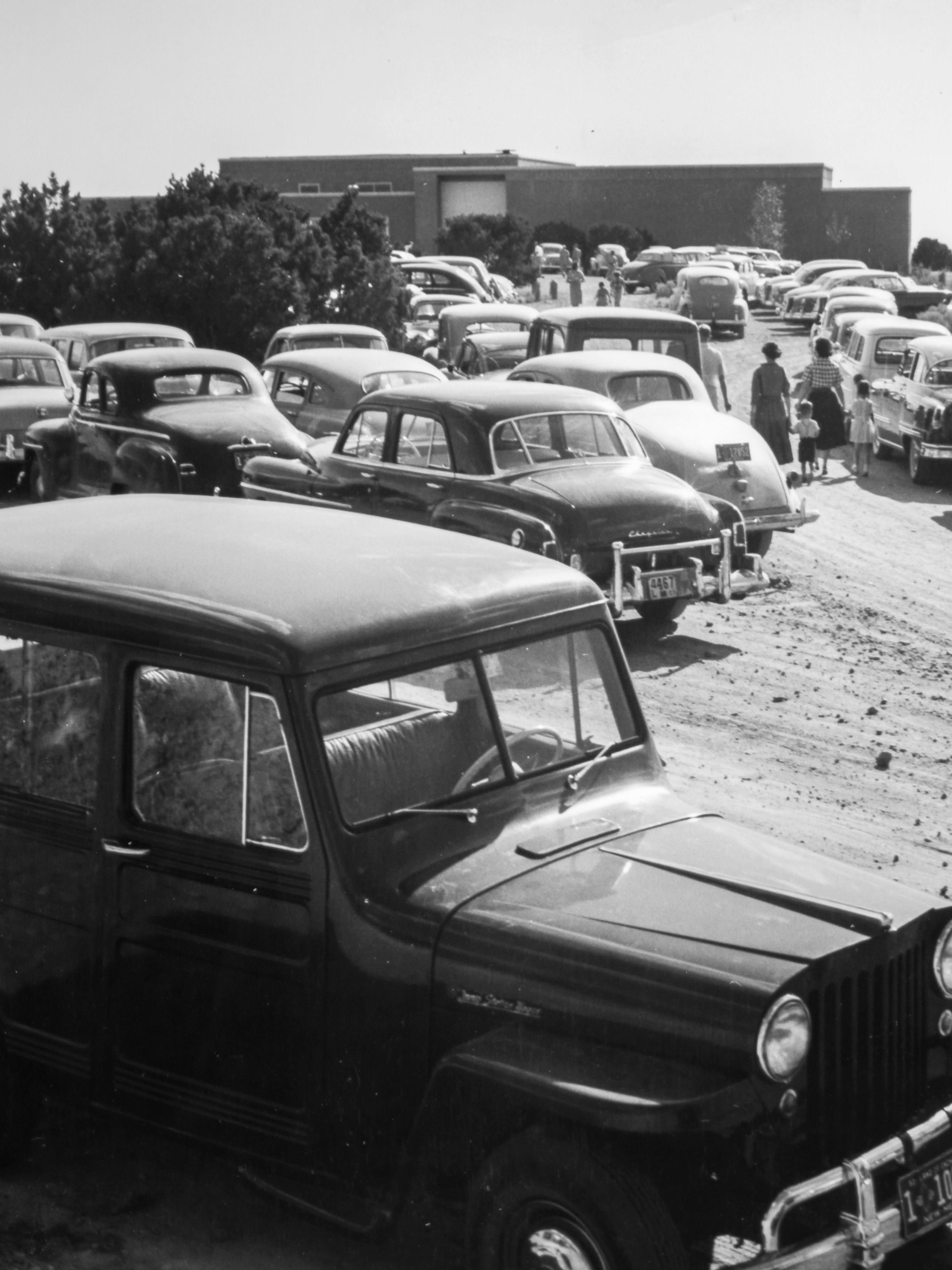 The dirt parking lot on Opening Day in 1953, original photographer unknown, cropped version of a digital image by Blair Clark, 2016